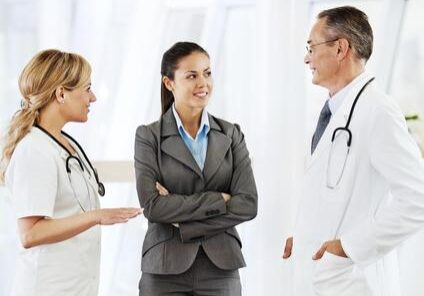 Two doctors explaining to a patient her medical condition.   [url=http://www.istockphoto.com/search/lightbox/9786662][img]http://dl.dropbox.com/u/40117171/medicine.jpg[/img][/url]